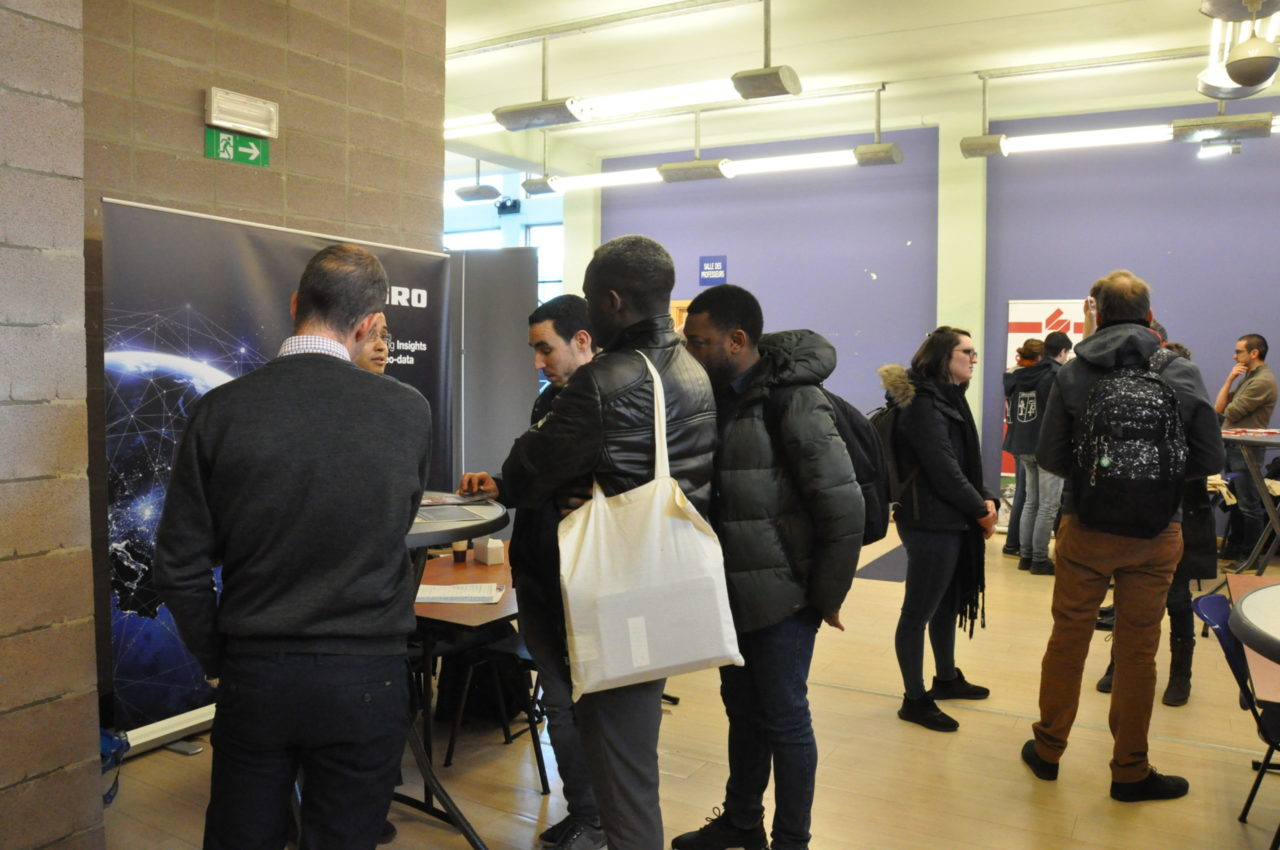 students looking at booths